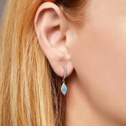 Sterling silver dangle earrings with blue stone