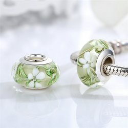 clear-green glass bead with flowers