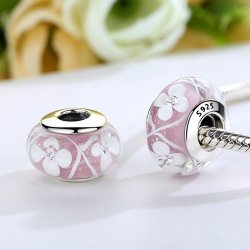 pink glass bead with white flowers